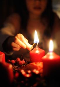child lighting advent wreath